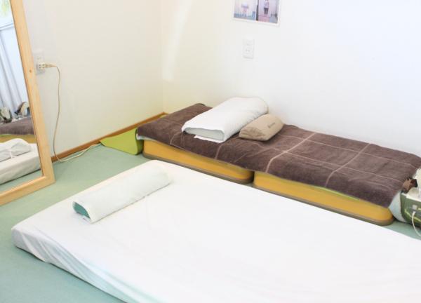 やえざきカイロプラクティック ベッド